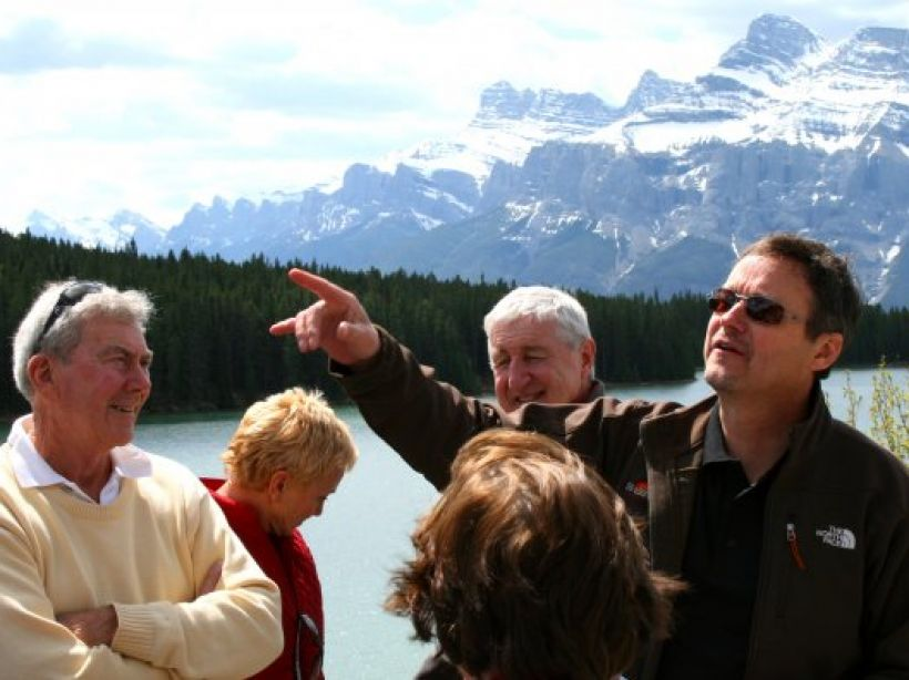 SunDog Tours' guide and senior travellers in a tour in Jasper National Park