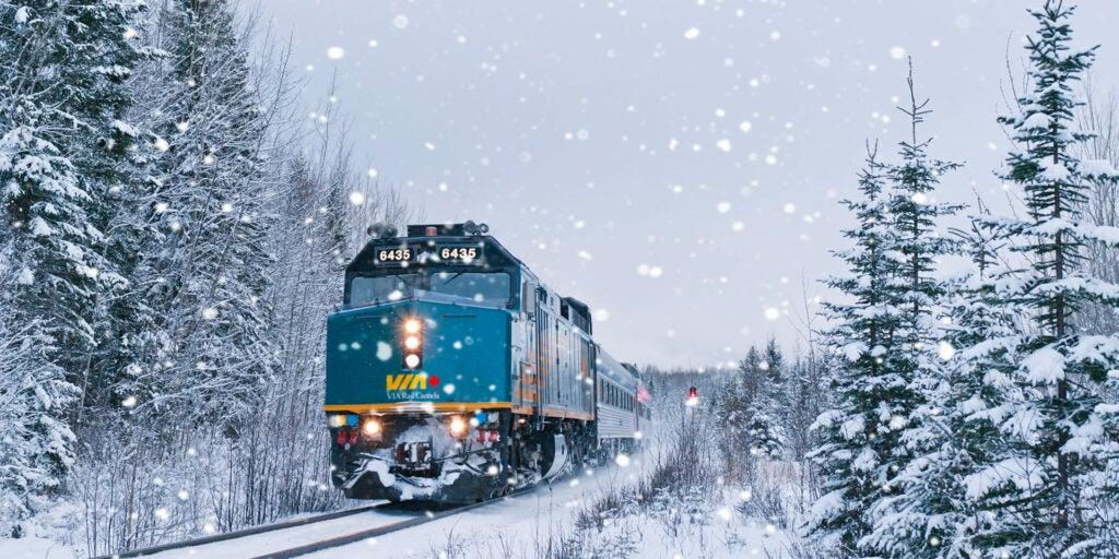 The Jasper Train travelling through snow-covered land in Jasper National Park