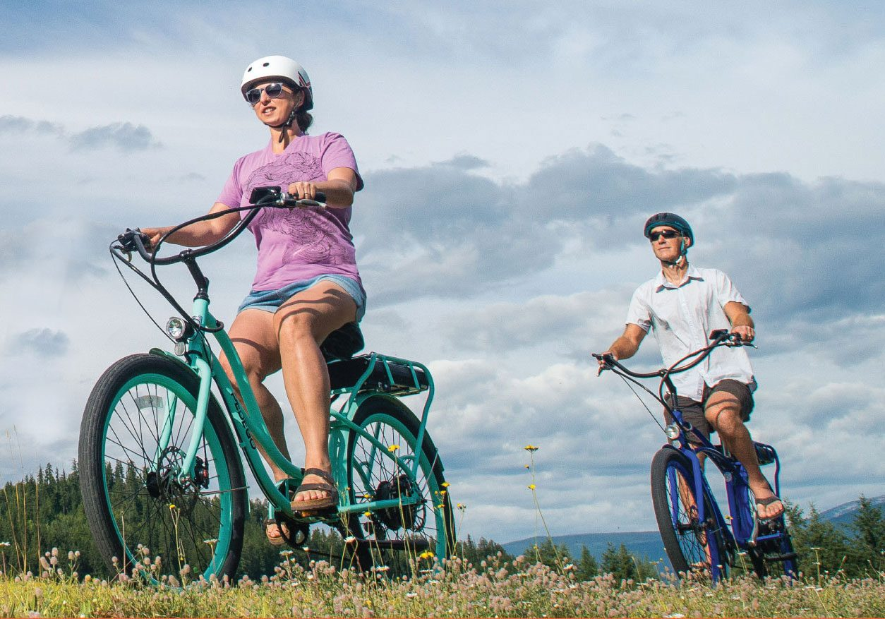 Two individuals biking in the fields of Jasper National Park